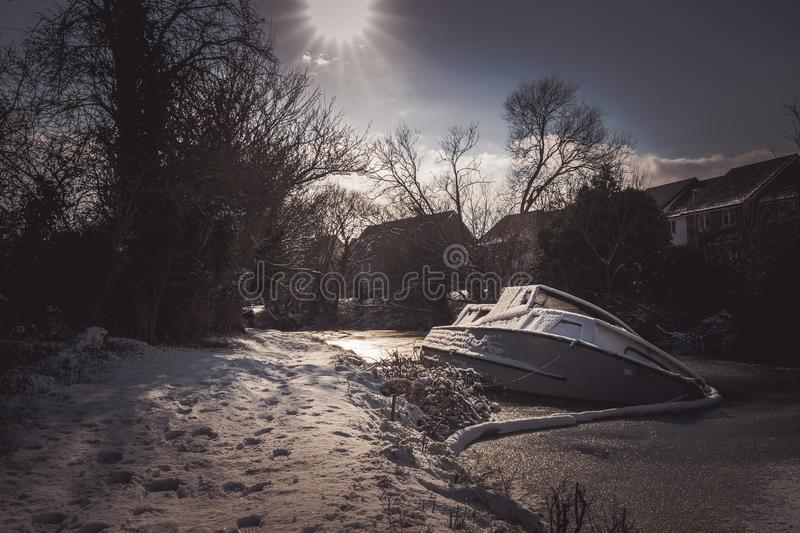 White Yacht on Snowy Pavement stock photos