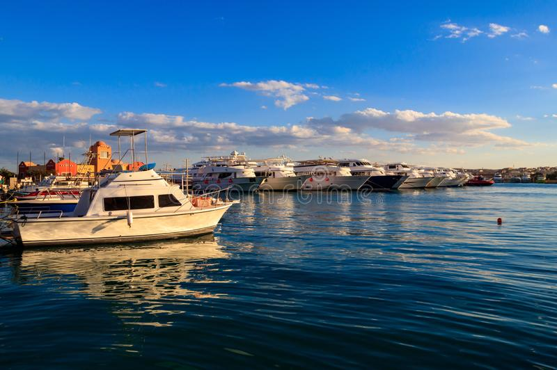 White yachts in the sea harbor of Hurghada, Egypt. Port with tourist boats on the Red Sea royalty free stock images