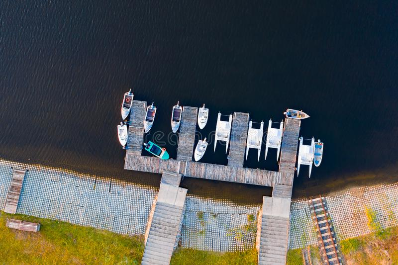 White yachts and speedboats parked along shore, aerial landscape stock photo