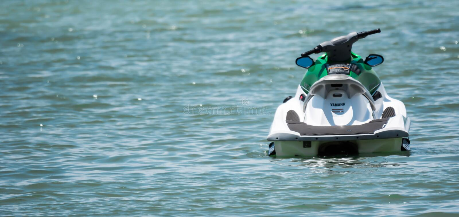 A yamaha jetski while parked and floating on a beach resort, Bintan Indonesia, December 16, 2018. A white yamaha jetski while parked and floating on a beach stock images