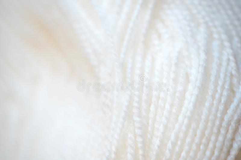 White yarn close-up shot. Woolen threads for knitting macro. White yarn close-up shot. Woolen threads for knitting a macro. Fabric background texture royalty free stock images