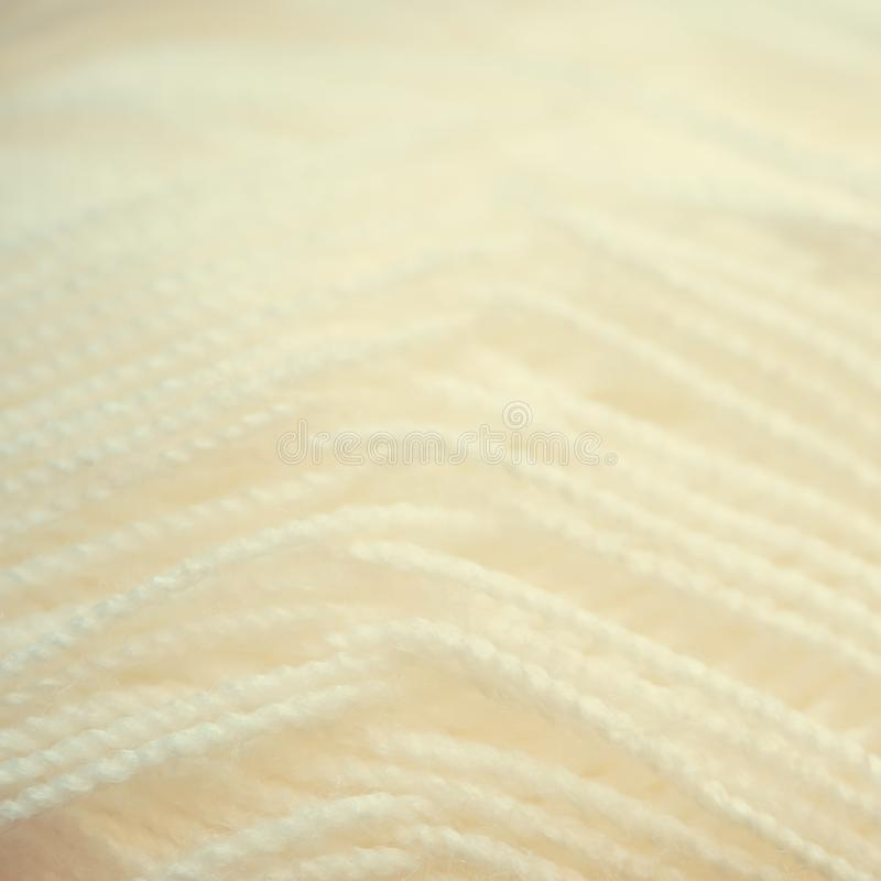 White yarn close-up shot. Woolen threads for knitting macro. White yarn close-up shot. Woolen threads for knitting a macro. Fabric background texture. Vintage royalty free stock images