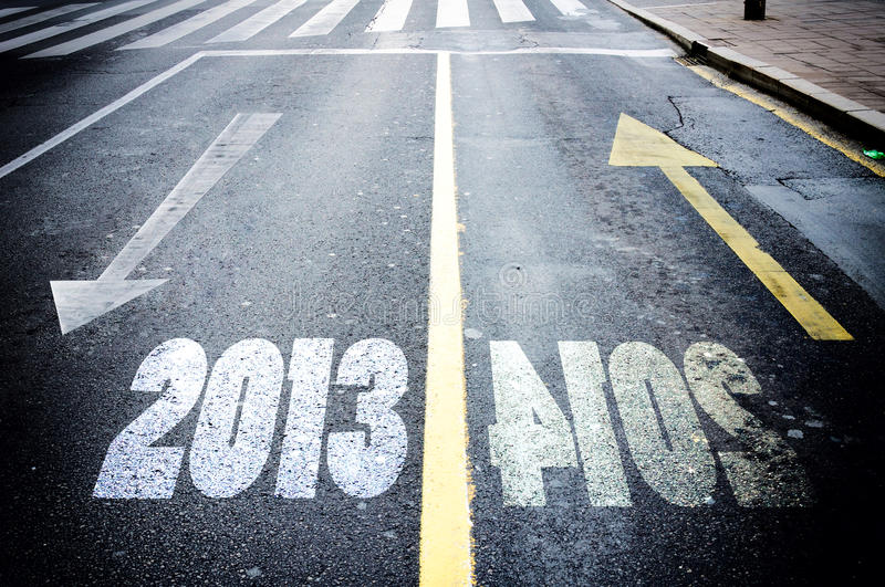 White and yellow arrow. Showing passed and new year stock images