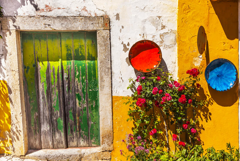 White Yellow Wall Green Door Mediieval City Obidos Portugal stock photo