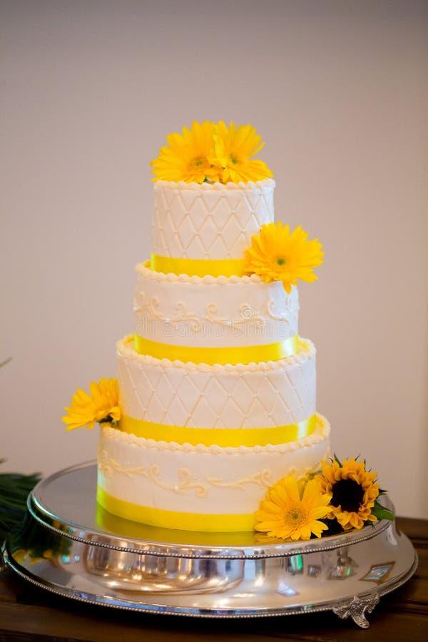White and Yellow Wedding Reception Cake stock photo