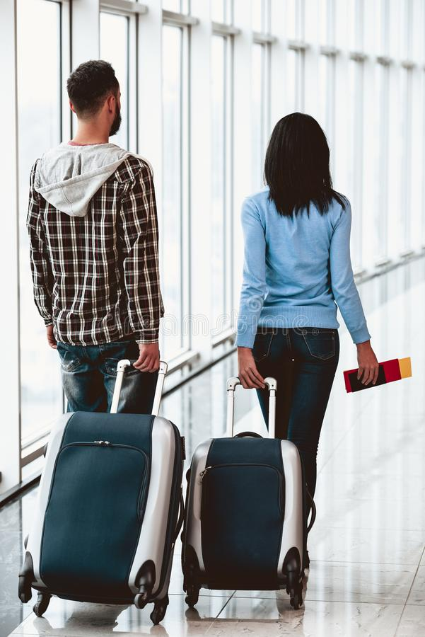 White young couple with suitcases at airport royalty free stock photos
