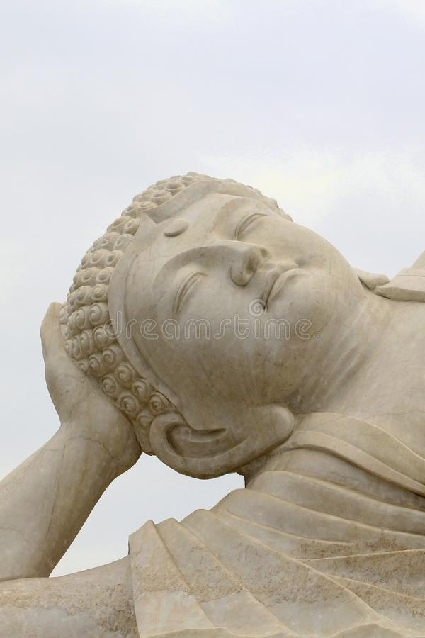 Face of a white Zen Buddha in close-up royalty free stock photography