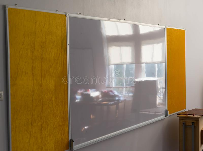 Whiteboard at wall with beside window reflect stock images