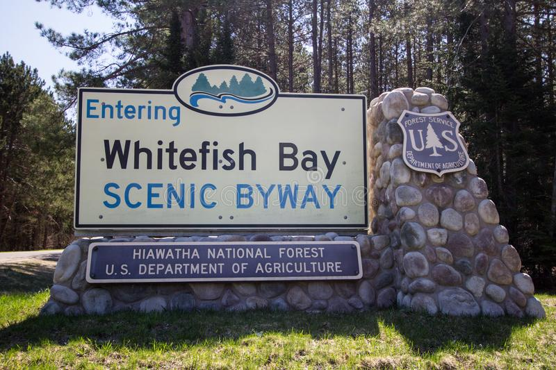 Whitefish Bay Scenic Byway In Michigan Upper Peninsula. Brimley, Michigan, USA - May 7, 2016: Entrance sign to the Whitefish Bay National Scenic Byway in the stock photography