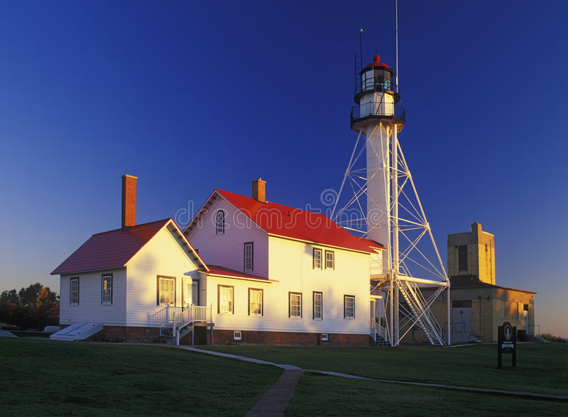 Whitefish Point Lighthouse. First light on Whitefish Point Lighthouse. Lake Superior in Michigan's Upper Peninsula. This is the 590,000th image online royalty free stock photos