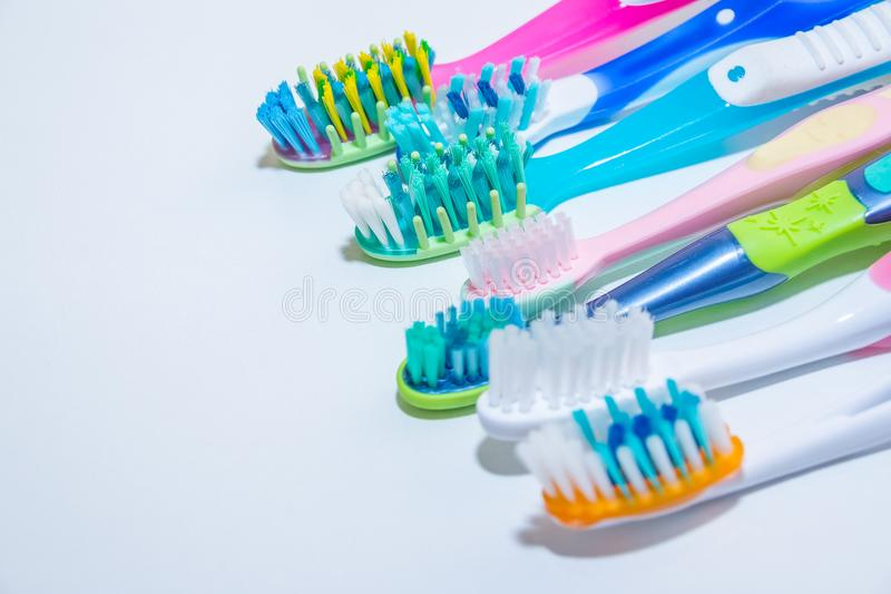 Whitening. tooth care. teeth healthy concept. New ultra soft toothbrushes in a row, Dental Industry. various types of royalty free stock image