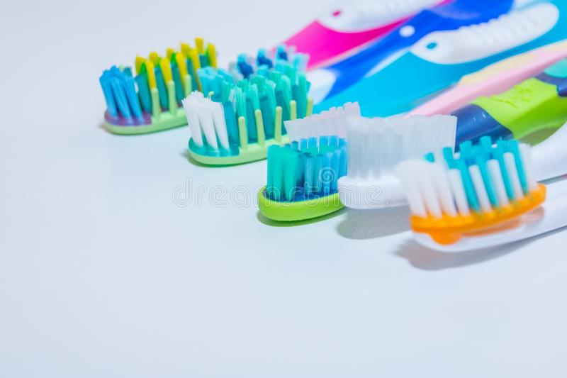 Whitening. tooth care. teeth healthy concept. New ultra soft toothbrushes in a row, Dental Industry. various types of stock photos