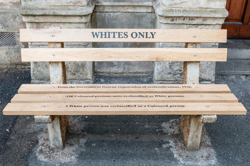 Whites only - reconstructed apartheid bench in Cape Town. CAPE TOWN, SOUTH AFRICA - DECEMBER 18TH, 2014: Reconstructed apartheid bench in front of the High Court royalty free stock photo