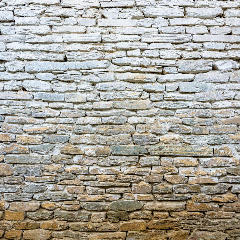 Whitewash old stone wall stock image