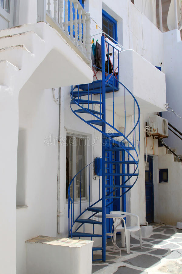 Whitewashed House with spiral staircase, Paros stock image