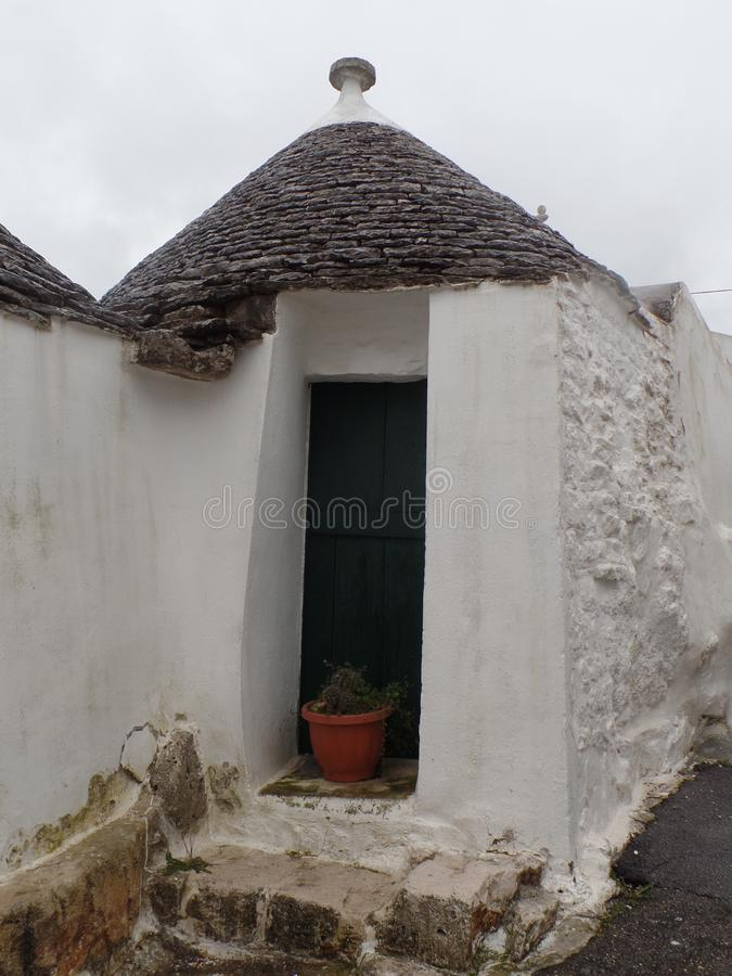 Whitewashed trulli house in Alberobello, Puglia, Southern Italy royalty free stock image