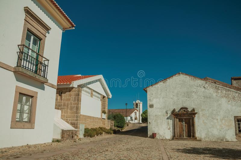 Whitewashed wall in old houses and entrance with stone door frame stock image