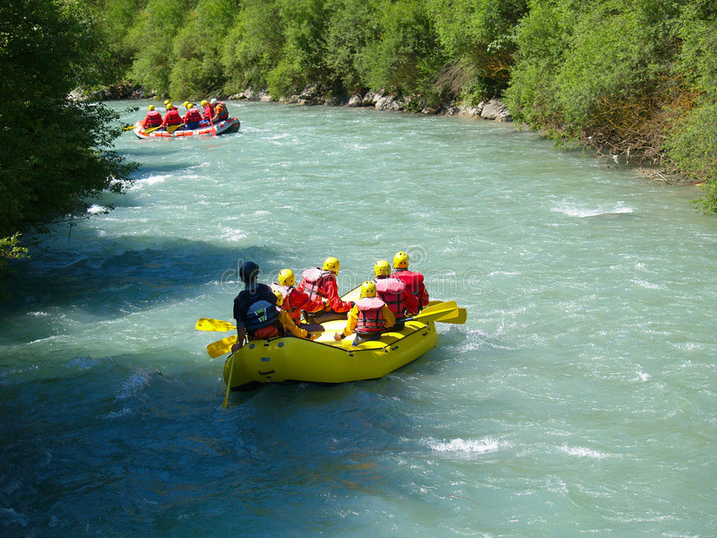 Whitewater rafting. In a little yellow boat royalty free stock image