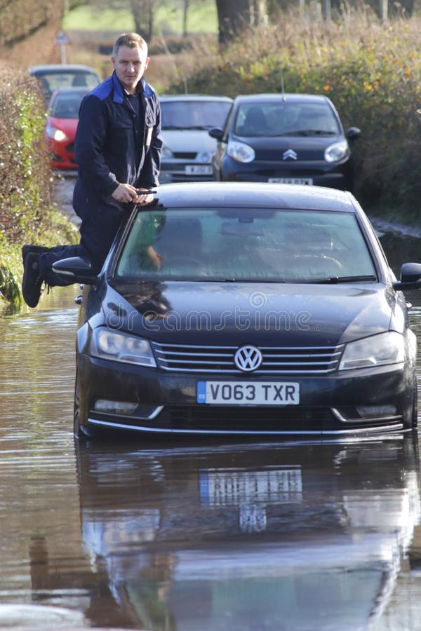 Driver rescued from flooded vehicle royalty free stock photos