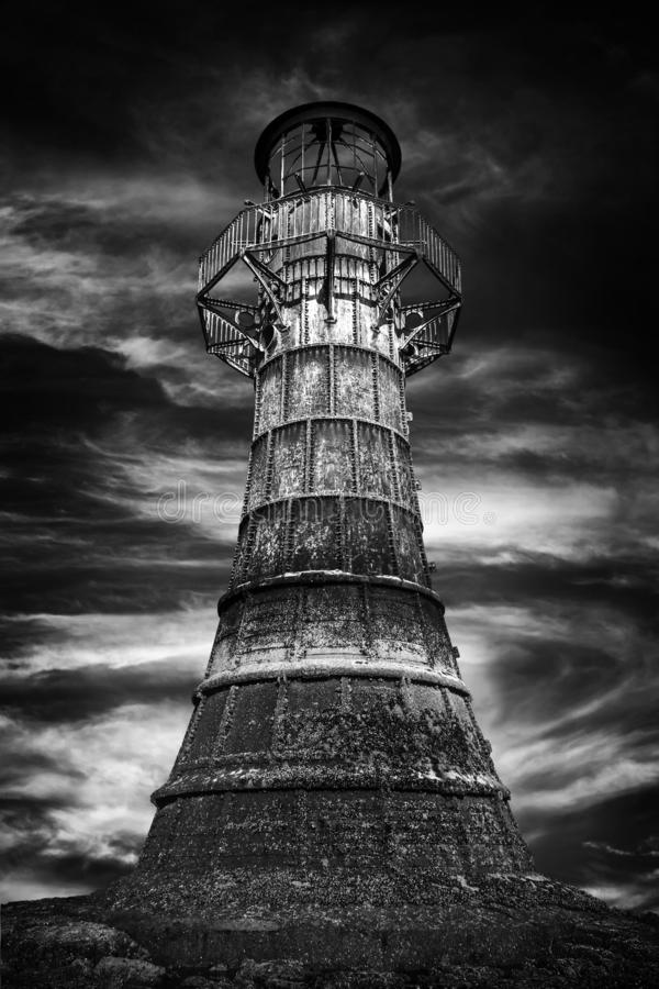Whitford Lighthouse, Wales. Whitford Lighthouse a cast iron Victorian ruin on the north coast of the Gower Peninsular Wales UK black & white monochrome image royalty free stock images