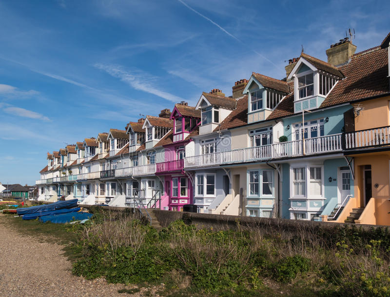 Whitstable, Kent, UK - Terrace houses. WHIITSTABLE, UK - APRIL 4 2016. The sun shines on the pretty Wave Crest Victorian terrace, row houses on the seafront in royalty free stock photos