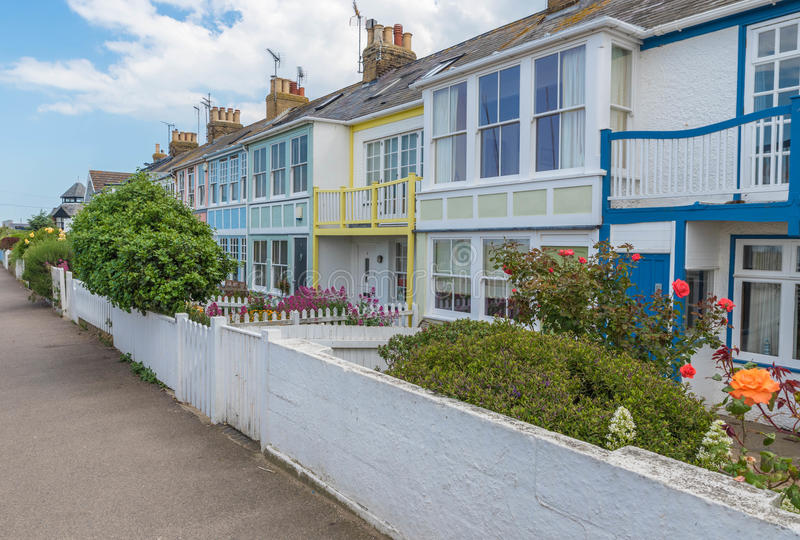 Whitstable, Kent, UK - Terrace houses. WHIITSTABLE, UK - May 2017. The sun shines on the pretty Wave Crest Victorian terrace, row houses on the seafront in stock images