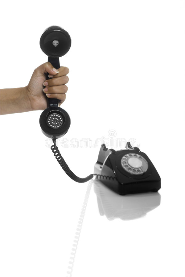 Who is it?. Male hand holding an hold vintage phone stock photography