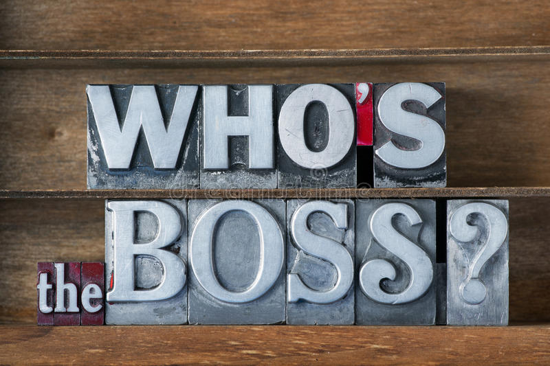 Who is the boss. Question made from metallic letterpress type on wooden tray stock photography