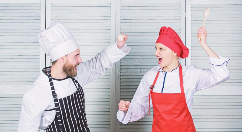 Who cook better. Culinary battle concept. Woman and bearded man culinary show competitors. Ultimate cooking challenge. Who cook better. Culinary battle concept royalty free stock image