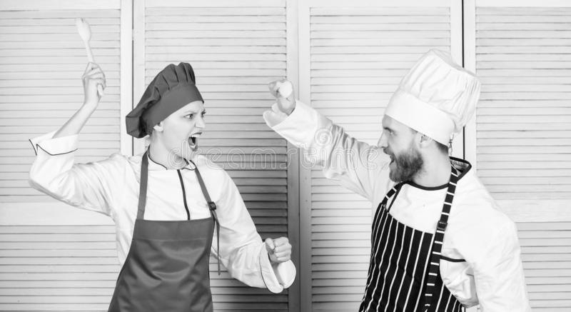 Who cook better. Culinary battle concept. Woman and bearded man culinary show competitors. Ultimate cooking challenge. Who cook better. Culinary battle concept royalty free stock photography