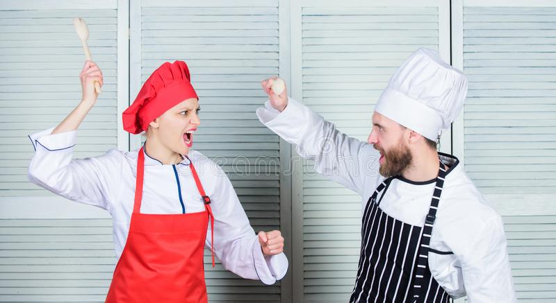 Who cook better. Culinary battle concept. Woman and bearded man culinary show competitors. Ultimate cooking challenge. Who cook better. Culinary battle concept stock photos