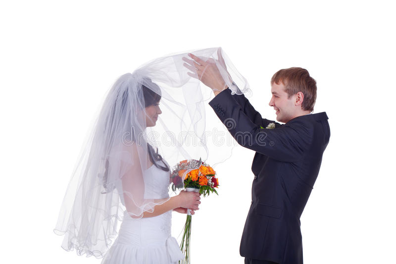 Who is the girl did I marry?. Groom takes first look on bride stock photos