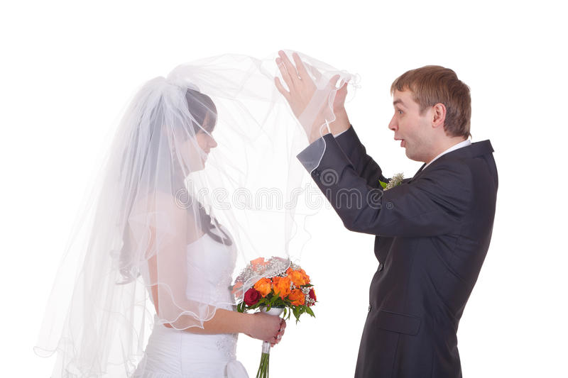 Who is the girl did I marry?. Groom takes a first look on feature wife stock photos