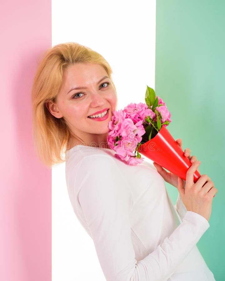 Who is her secret admirer Lady happy received flowers from secret admirer. Woman smiling dreamy try guess who fall in. Love with her. Girl hold bouquet flowers stock photography