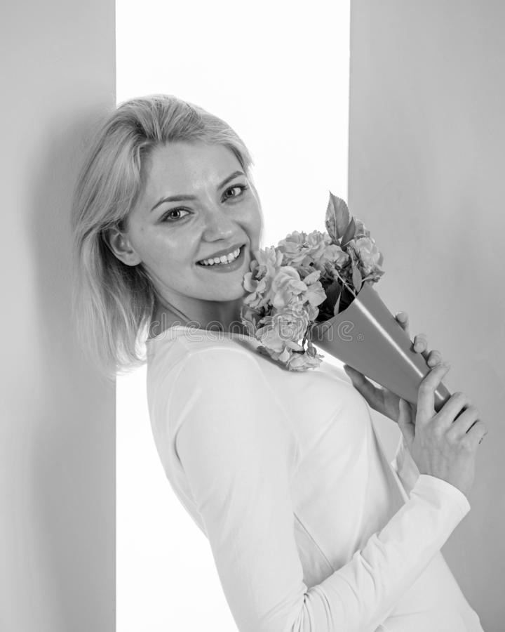 Who is her secret admirer Lady happy received flowers from secret admirer. Woman smiling dreamy try guess who fall in. Love with her. Girl hold bouquet flowers stock photo