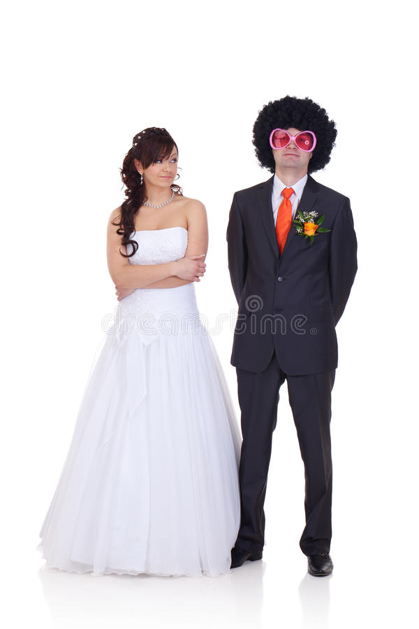 Who is the man I did marry?. Bride is wondering who is the guy she did marry, because he looks like a disco dancer stock image