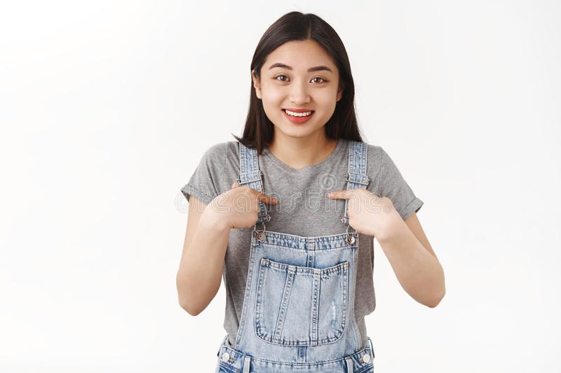 Who me. Impressed cheerful cute asian vietnamese girl surprised pointing herself happy was chosen pleased got cool stock photos