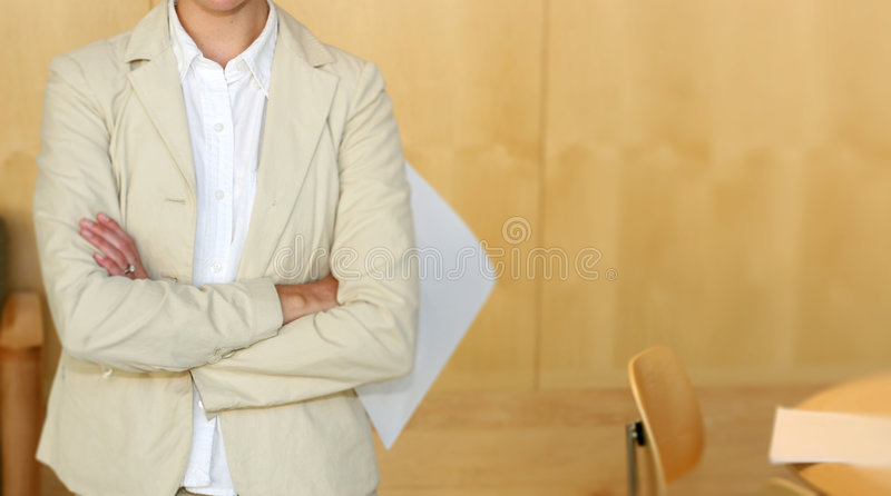 Who's the boss?. Young businesswoman stands posed with paperwork royalty free stock photos