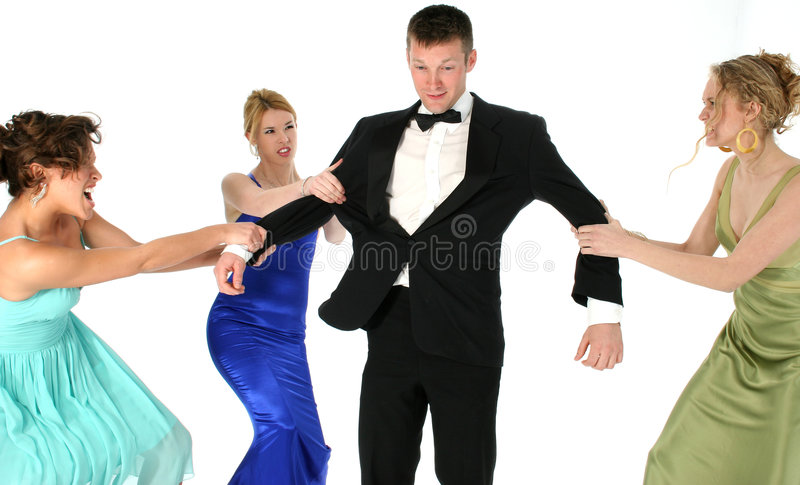 Who's Man Is He?. Three beautiful young woman in formal dresses fighting over handsome man in tuxedo. Shot in studio over white