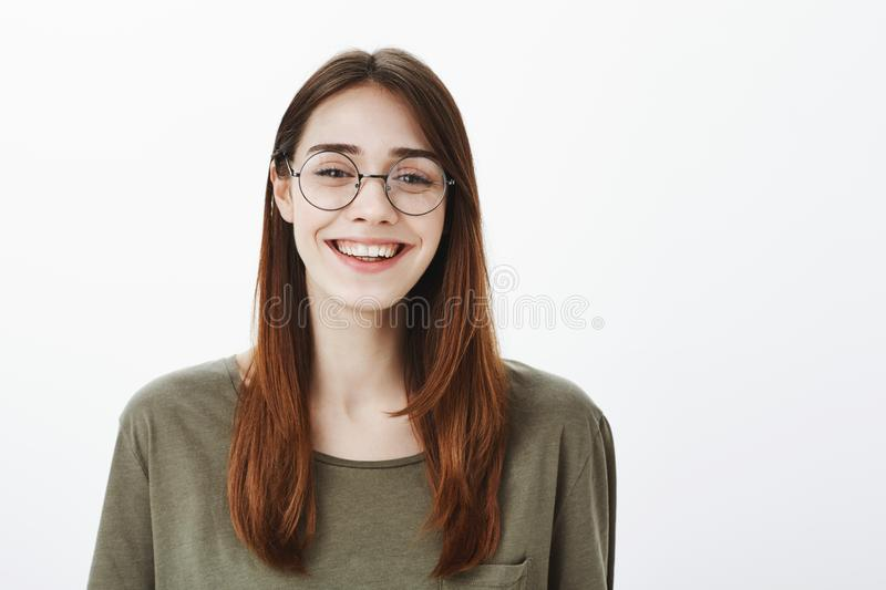 Who says glasses for nerds. Portrait of happy good-looking friendly woman in trendy eyewear, smiling broadly and royalty free stock image