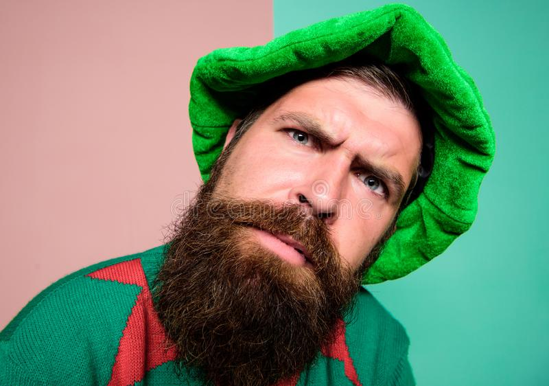 Who is there. Picky man looking at camera. Bearded elf. Winter carnival. St Patricks day. Hipster with beard wearing stock image