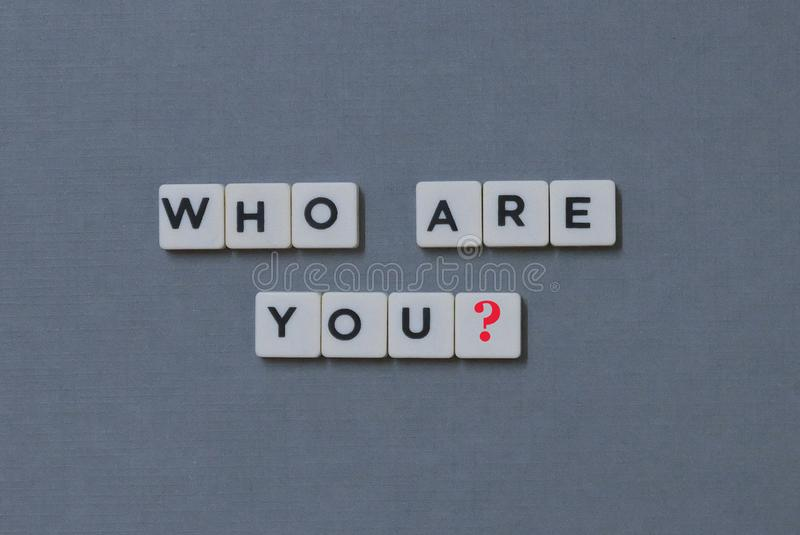 ' Who Are You? ' word made of square letter word on grey background stock image