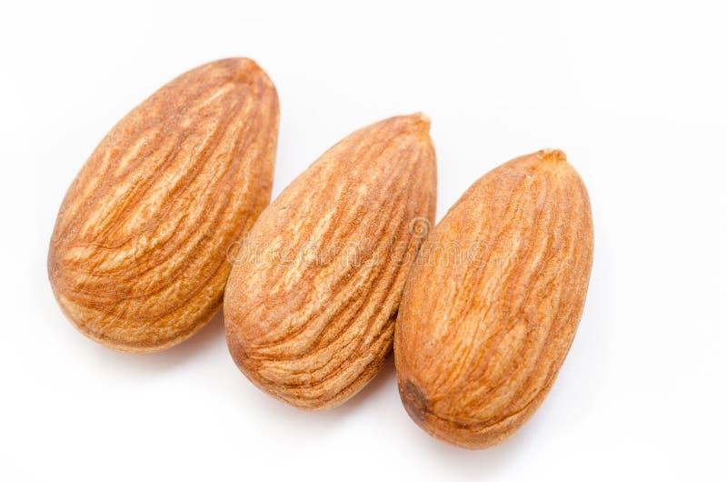 Whole almonds on a white background royalty free stock photos