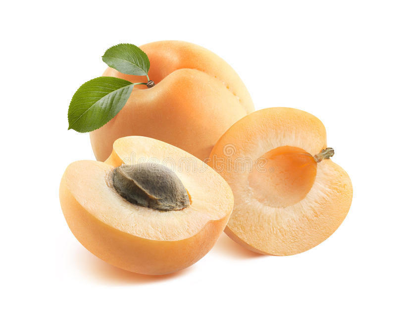 Whole apricot and two halves 2 isolated on white background. Whole apricot and two halves with seed 2 isolated on white background as package design element stock photos
