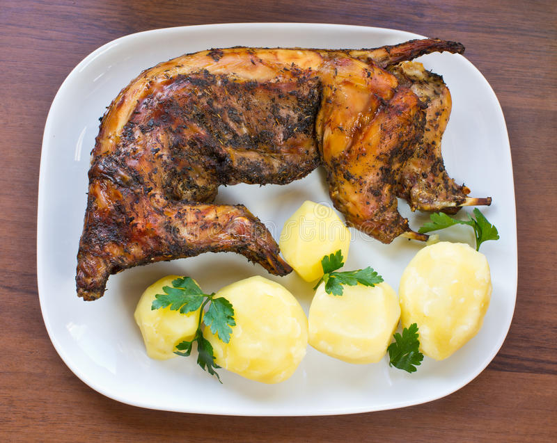 Whole baked rabbit royalty free stock photography