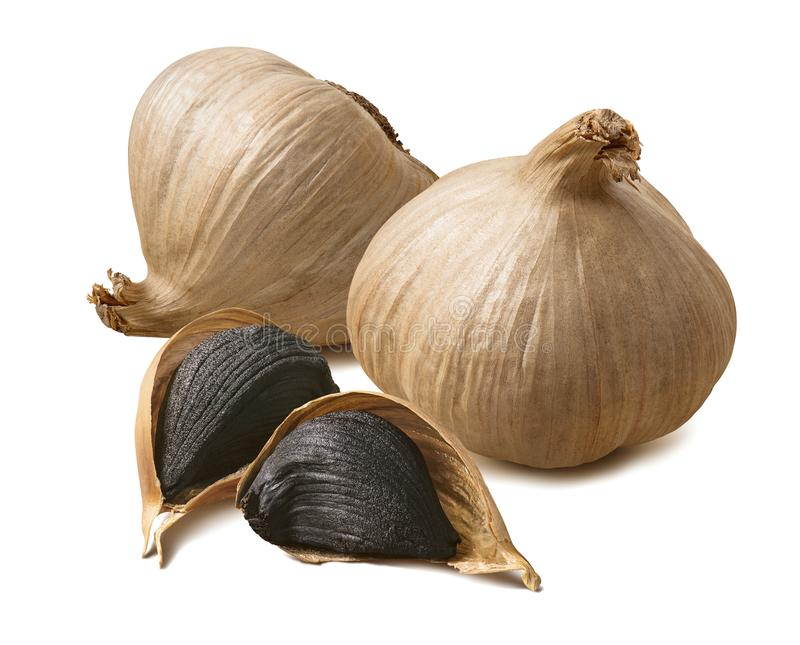 Whole black garlic bulbs and cloves isolated on white background royalty free stock photo