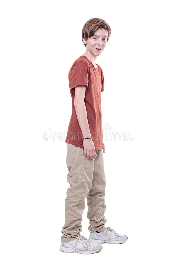 Whole body portrait of a smiling male teenager. Isolated on white royalty free stock image