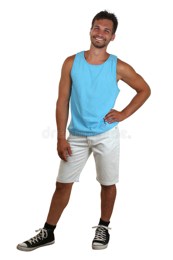 Whole body portrait of a young smiling man in muscle shirt. Isolated on a white background royalty free stock image