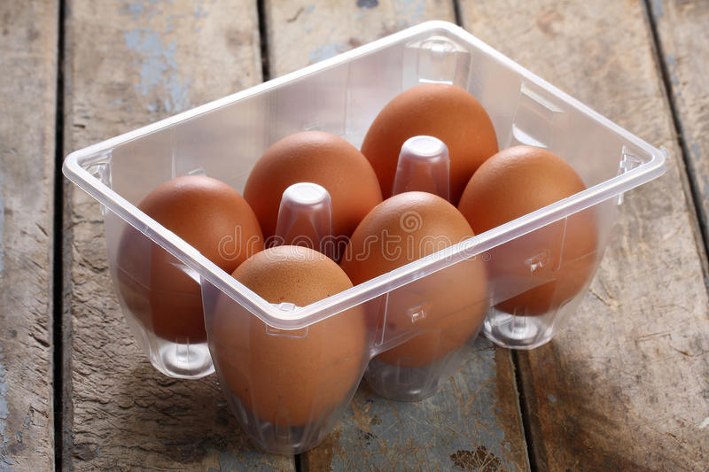 Whole Brown Eggs in Box royalty free stock photos