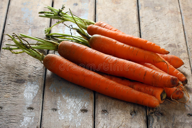 Whole Carrots on Table stock photo